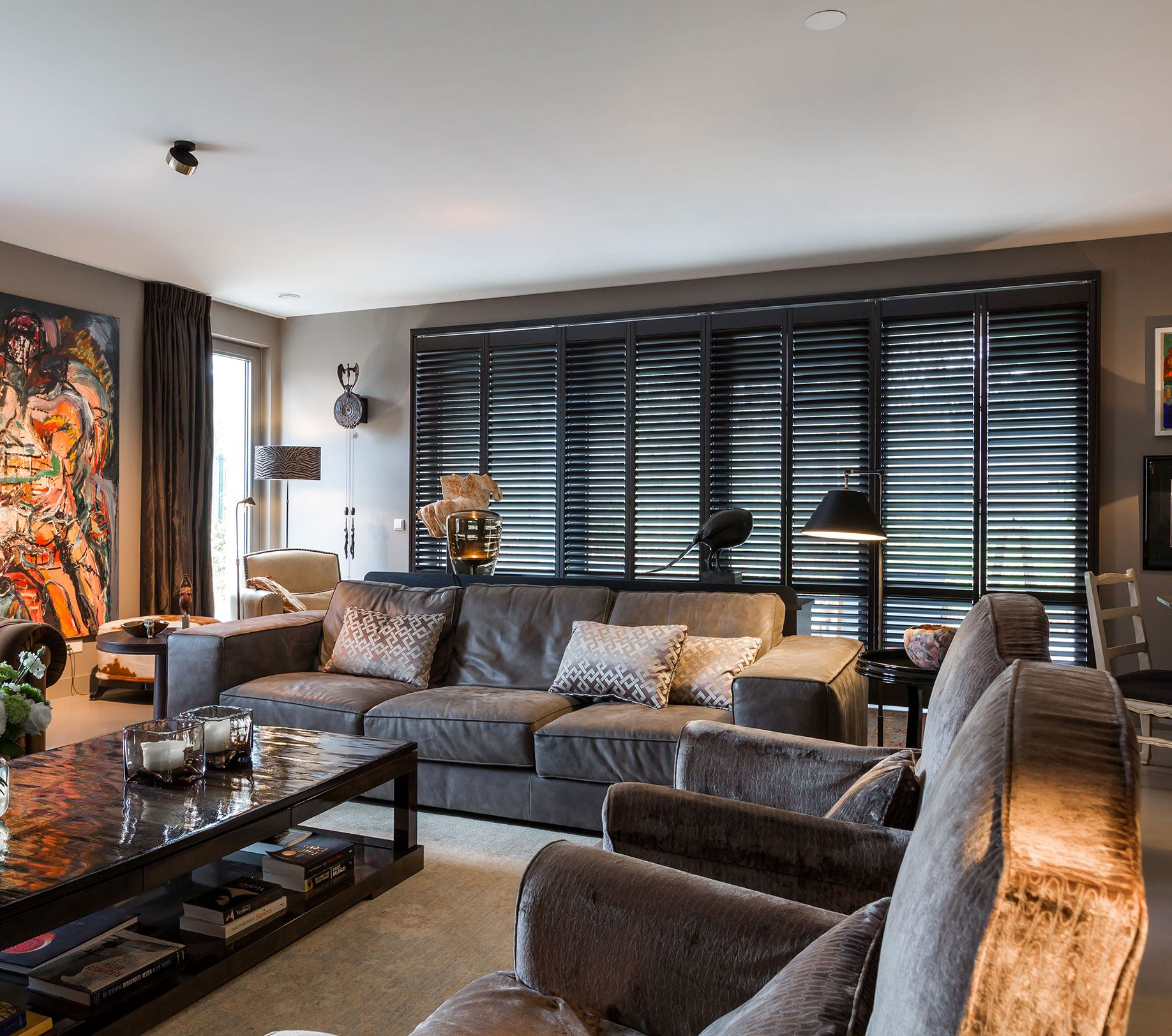 Raamstyling shutters inrichting woonkamer